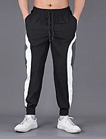 cheap -Men's Athleisure Sports Outdoor Sports Pants Sweatpants Cotton Slim Casual Sports Pants Solid Color Full Length Patchwork Black / Drawstring / Elasticity