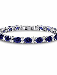 cheap -cz tennis bracelet - oval 7x5 syn blue sapphire & round 2.50mm white cz - silver over brass - 7 inch