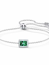 cheap -swarovski angelic bracelet with green and clear crystals on a rhodium plated chain with a bolo style adjustable closure