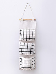 cheap -self-produced and self-sold creative cotton and linen waterproof storage hanging bag 3-layer hanging pocket lattice type fabric door storage bag