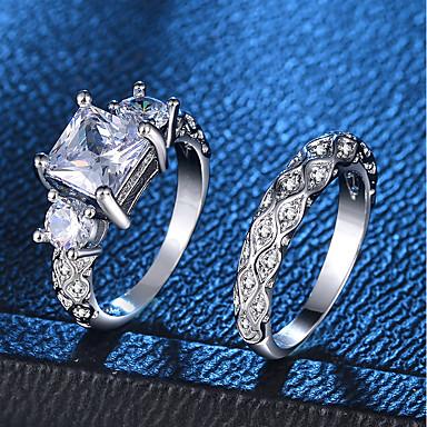 billige Motering-Dame Ring Ring Set 2pcs Sølv Kobber Platin Belagt Fuskediamant Fire tenger damer Romantikk Mote Bryllup Fest Smykker simulert 3 stein Fortid nåtid fremtid Kjærlighed Bølge Smuk