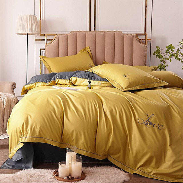 Duvet Cover Sets 4 Piece Rayon / Polyester Solid Colored Light Yellow Embroidery Simple / Quilted / 4pcs (1 Duvet Cover, 1 Flat Sheet, 2 Shams)